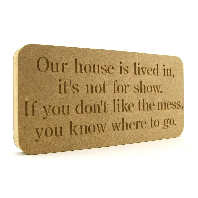 'Our house is lived in...' plaque.