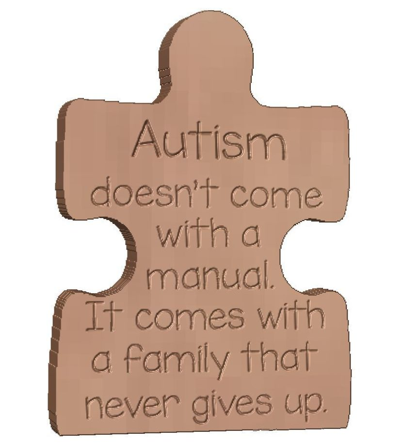 Puzzle Pieces engraved 'Autism doesn't come with....'. Autism.